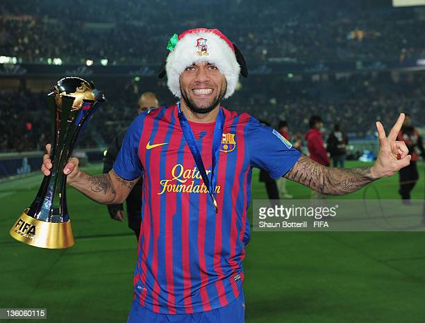 Dani Alves of Barcelona celebrates with the trophy after the FIFA Club World Cup Final match between Santos and Barcelona at the Yokohama...