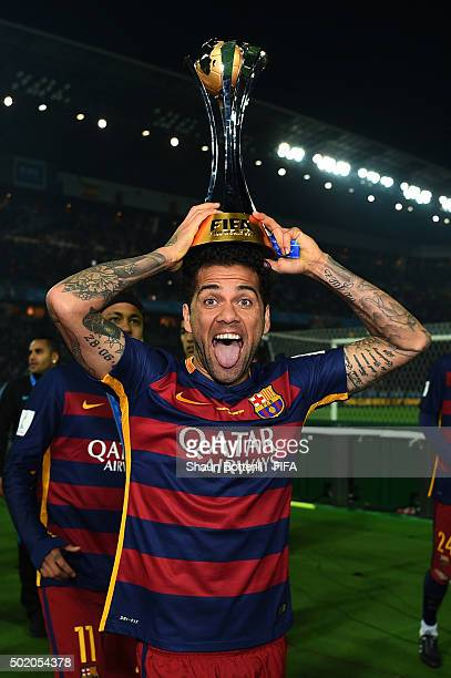 Dani Alves of Barcelona celebrates with the trophy following his team's 30 victory during the FIFA Club World Cup Final between River Plate and FC...