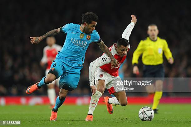 Dani Alves of Barcelona makes a tackle on Alexis Sanchez of Arsenal during the UEFA Champions League round of 16 first leg match between Arsenal and...