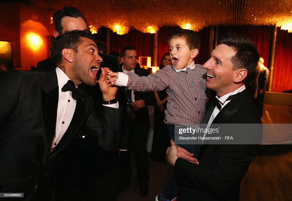 Dani Alves of Brazil and Barcelona jokes around with FIFA Ballon d'Or winner Lionel Messi of Argentina and Barcelona and his son Thiago after the FIFA Ballon d'Or Gala 2015 at the Kongresshaus on January 11, 2016 in Zurich, Switzerland.
