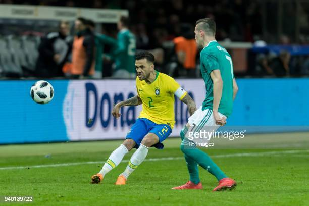 Dani Alves of Brazil and Julian Draxler of Germany battle for the ball during the international friendly match between Germany and Brazil at...