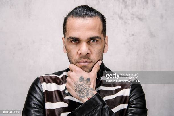Dani Alves of Brazil and Paris SaintGermain poses for a portrait prior to The Best FIFA Football Awards at London Marriott Hotel County Hall on...
