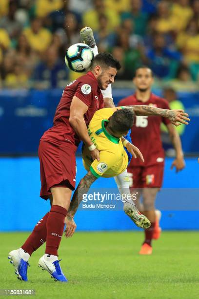 Dani Alves of Brazil attempts an over head kick against Junior Moreno of Venezuela during the Copa America Brazil 2019 group A match between Brazil...