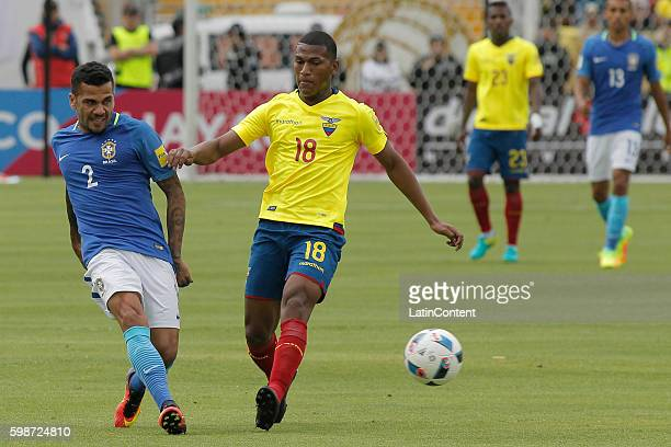 Dani Alves of Brazil battles a ball with Carlos Gruezo of Ecuador during a match between Ecuador and Brazil as part of FIFA 2018 World Cup Qualifiers...