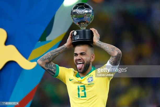 Dani Alves of Brazil celebrates with his trophy after winning the Copa America Brazil 2019 Final match between Brazil and Peru at Maracana Stadium on...