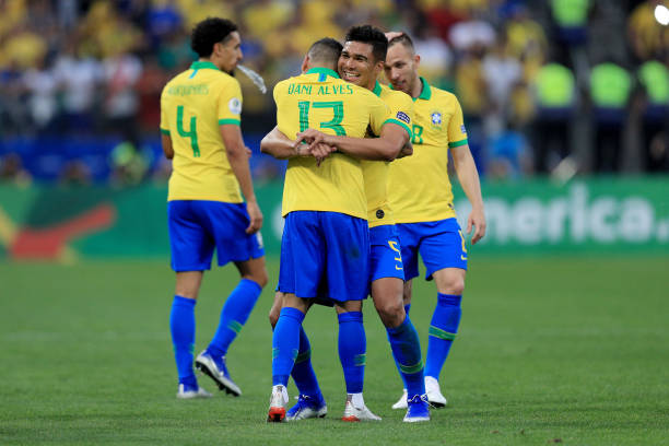 Dani Alves of Brazil celebrates with teammate Casemiro after scoring the fourth goal of his team during the Copa America Brazil 2019 group A match...
