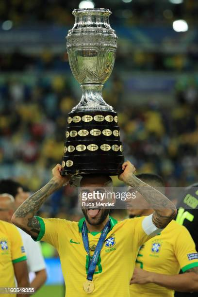 Dani Alves of Brazil celebrates with teh trophy after winning the Copa America Brazil 2019 Final match between Brazil and Peru at Maracana Stadium on...