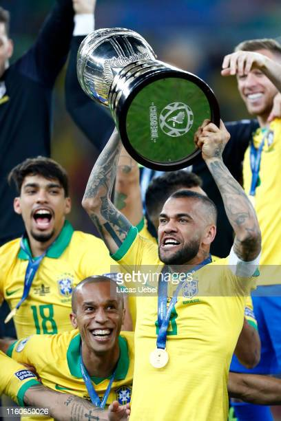 Dani Alves of Brazil celebrates with the trophy after winning the Copa America Brazil 2019 Final match between Brazil and Peru at Maracana Stadium on...