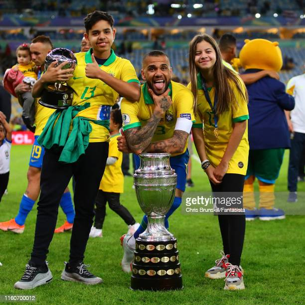 Dani Alves of Brazil celebrates with the trophy alongside his family following the Copa America Brazil 2019 Final match between Brazil and Peru at...
