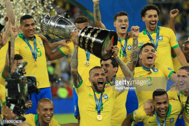 Dani Alves of Brazil celebrates with the trophy and his teammates after winning the Copa America Brazil 2019 Final match between Brazil and Peru at...