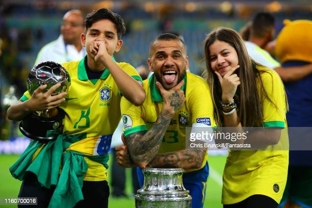 Dani Alves of Brazil celebrates with the trophyalongside his family following the Copa America Brazil 2019 Final match between Brazil and Peru at...