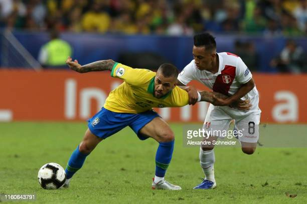 Dani Alves of Brazil competes for the ball with Christian Cueva of Peru during the Copa America Brazil 2019 Final match between Brazil and Peru at...