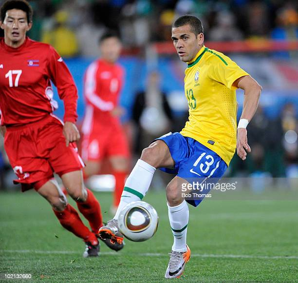 Dani Alves of Brazil controls the ball against An Yong Hak of North Korea during the 2010 FIFA World Cup South Africa Group G match between Brazil...