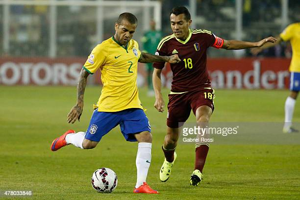 Dani Alves of Brazil fights for the ball with Juan Arango of Venezuela during the 2015 Copa America Chile Group C match between Brazil and Venezuela...