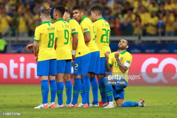 Dani Alves of Brazil gestures behind his teammates during the Copa America Brazil 2019 Semi Final match between Brazil and Argentina at Mineirao...