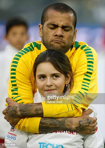 Dani Alves of Brazil hugs a little girl during the national anthem ceremony prior the 2015 Copa America Chile Group C match between Brazil and...