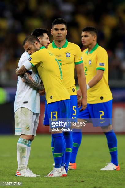 Dani Alves of Brazil hugs Lionel Messi of Argentina during the Copa America Brazil 2019 Semi Final match between Brazil and Argentina at Mineirao...