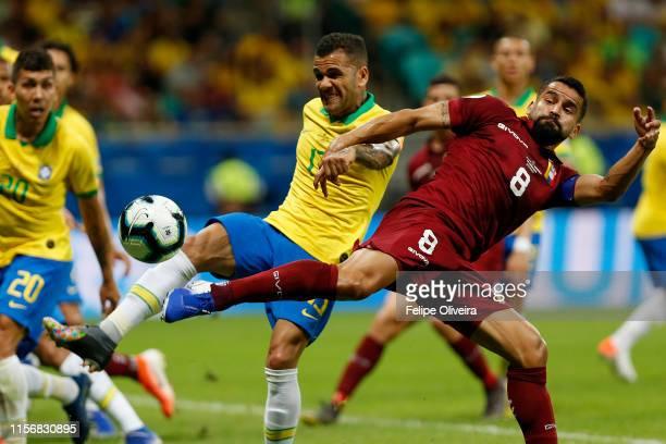 Dani Alves of Brazil kicks the ball against Tomas Rincon of Venezuela during the Copa America Brazil 2019 group A match between Brazil and Venezuela...