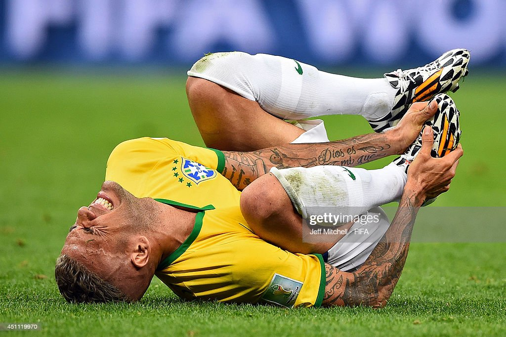 Dani Alves of Brazil lies on the field after a challenge during the 2014 FIFA World Cup Brazil Group A match between Cameroon and Brazil at Estadio Nacional on June 23, 2014 in Brasilia, Brazil.