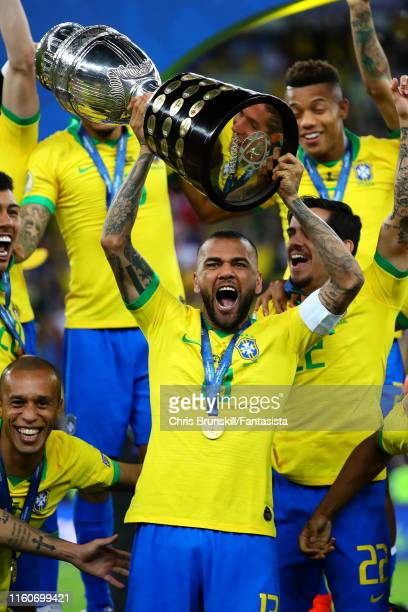 Dani Alves of Brazil lifts the trophy following the Copa America Brazil 2019 Final match between Brazil and Peru at Maracana Stadium on July 07 2019...