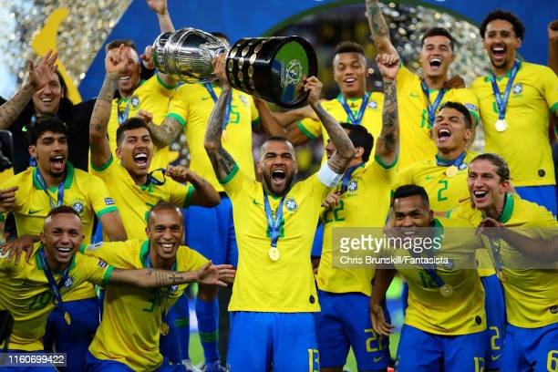 Dani Alves of Brazil lifts the trophy following the Copa America Brazil 2019 Final match between Brazil and Peru at Maracana Stadium on July 07, 2019...
