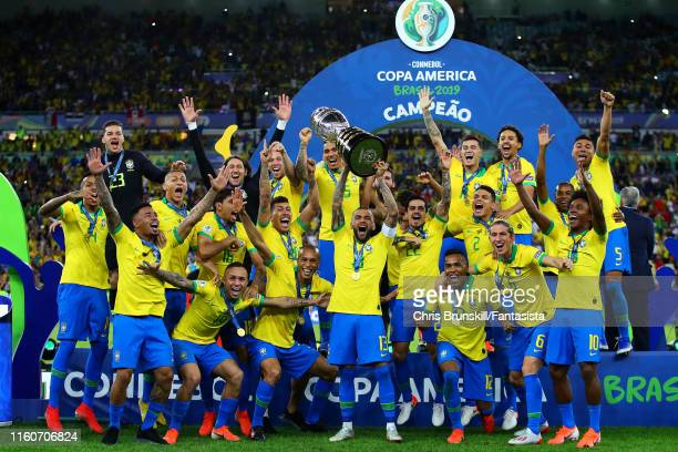 Dani Alves of Brazil lifts the trophy following the Copa America Brazil 2019 Final match between Brazil and Peru at Maracana Stadium on July 07, 2019...