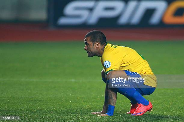 Dani Alves of Brazil looks dejected after the penalty shootout during the 2015 Copa America Chile quarter final match between Brazil and Paraguay at...