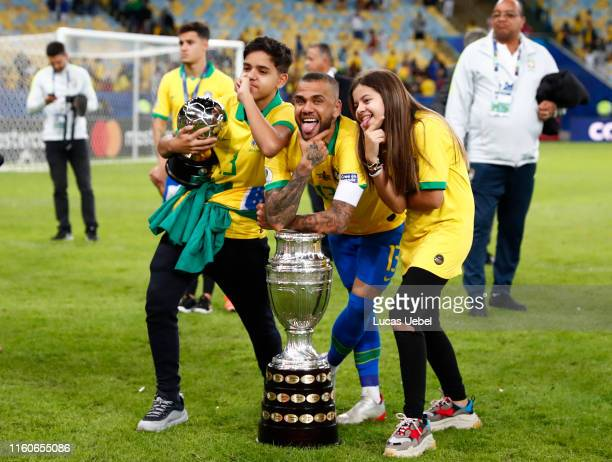 Dani Alves of Brazil poses with his children after winning the Copa America Brazil 2019 Final match between Brazil and Peru at Maracana Stadium on...
