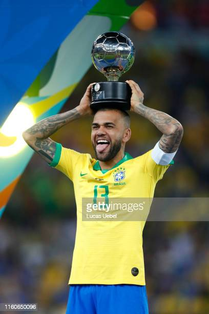 Dani Alves of Brazil poses with his trophy after winning the Copa America Brazil 2019 Final match between Brazil and Peru at Maracana Stadium on July...