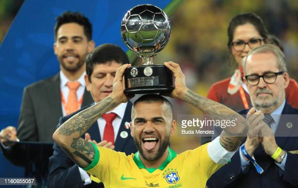 Dani Alves of Brazil poses with the trophy of Best Player of the tournament after winning the Copa America Brazil 2019 Final match between Brazil and...