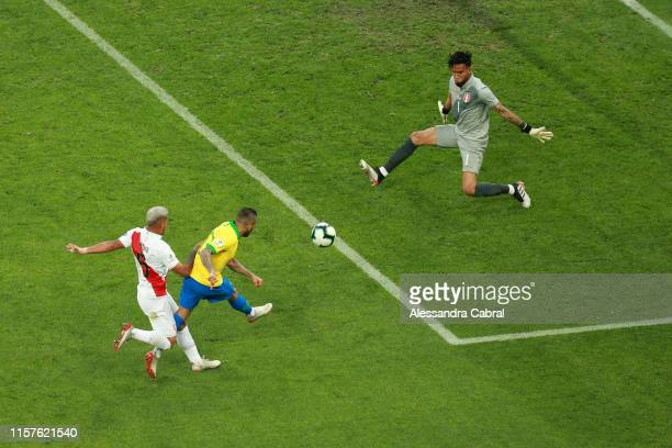 Dani Alves of Brazil shoots on target to score the fourth goal of his team during the Copa America Brazil 2019 group A match between Peru and Brazil...