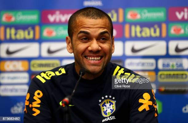 Dani Alves of Brazil speaks during a Brazil Press Conference ahead of the International Friendly Match between England and Brazil on November 13,...