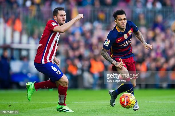 Dani Alves of FC Barcelona and Jorge Resurreccion 'Koke' of Club Atletico de Madrid compete for the ball during the La Liga match between FC...