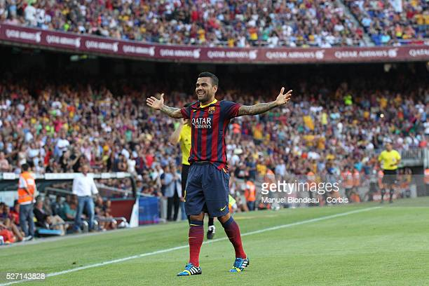 Dani Alves of FC Barcelona celebrates after scoring his sides third goal during the Spanish league football match between FC Barcelona and Levante UD...