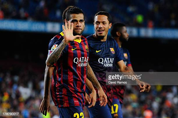 Dani Alves of FC Barcelona celebrates after winning the Spanish Super Cup during the Spanish Super Cup second leg match between FC Barcelona and...