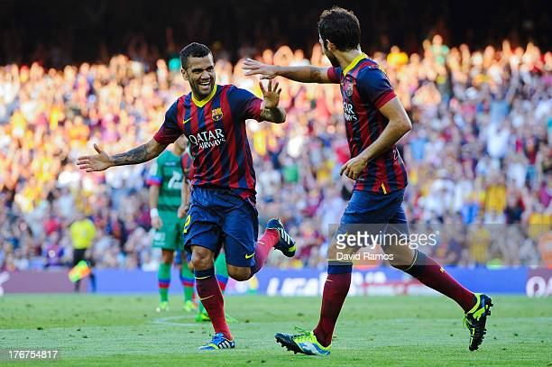 Dani Alves of FC Barcelona celebrates with his teammate Cesc Fabregas after scoring his team's third goal during the La Liga match between FC...