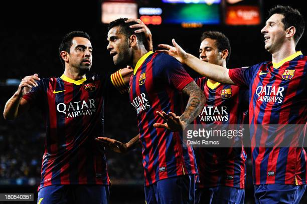 Dani Alves of FC Barcelona celebrates with his teammates Xavi Hernandez Neymar and Lionel Messi of FC Barcelona after scoring the opening goal the La...