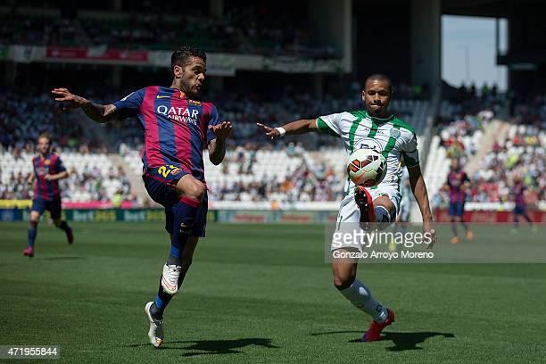 Dani Alves of FC Barcelona competes for the ball with Edimar Fraga of Cordoba CF during the La Liga match between Cordoba CF and Barcelona FC at El...