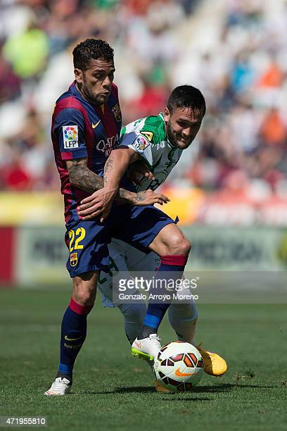 Dani Alves of FC Barcelona competes for the ball with Forin Andone of Cordoba CF during the La Liga match between Cordoba CF and Barcelona FC at El...