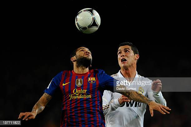 Dani Alves of FC Barcelona duels for a high ball with Cristiano Ronaldo of Real Madrid during the Copa del Rey quarter final second leg match between...