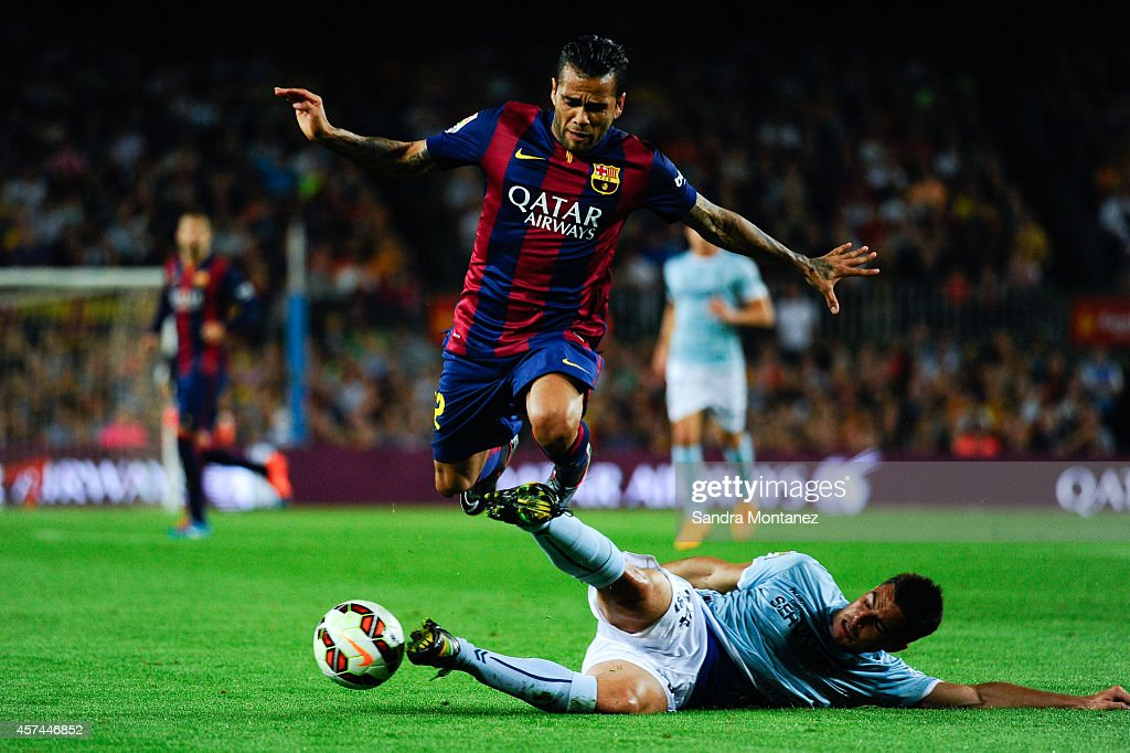 Dani Alves of FC Barcelona duels for the ball with Dani Garcia of SD Eibar during the La Liga match between FC Barcelona and SD Eibar at Camp Nou on October 18, 2014 in Barcelona, Spain.