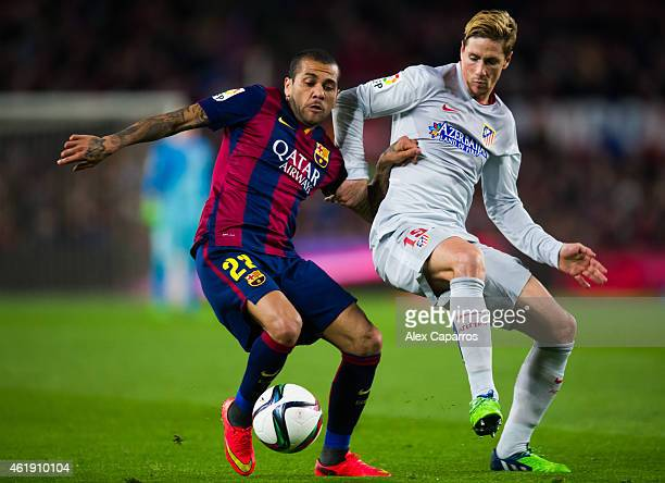 Dani Alves of FC Barcelona fights for the ball with Fernando Torres of Club Atletico de Madrid during the Copa del Rey QuarterFinal First Leg match...