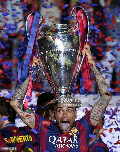 Dani Alves of FC Barcelona lifts the trophy following the UEFA Champions League Final match between Juventus and FC Barcelona at the Olympiastadion...