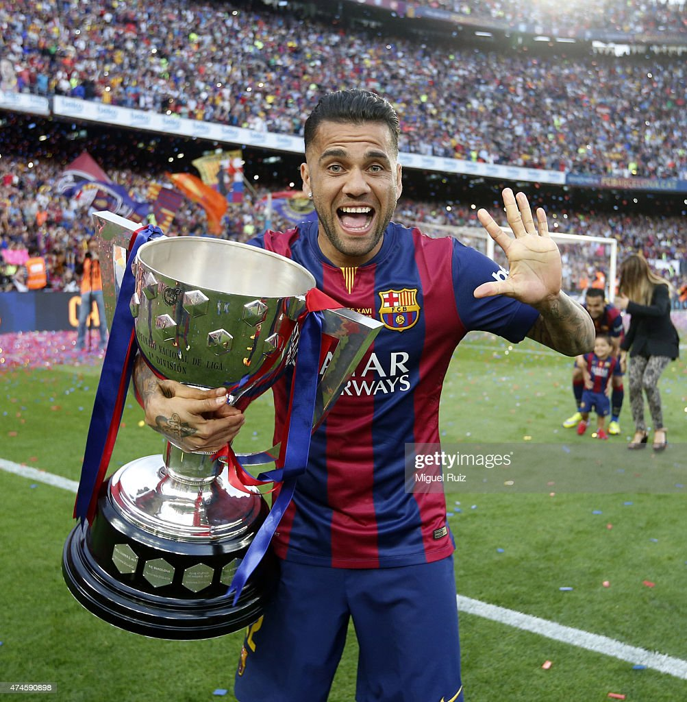 Dani Alves of FC Barcelona poses with La Liga trophy during the La Liga match between FC Barcelona and RC Deportivo La Coruña at Camp Nou on May 23, 2015 in Barcelona, Spain.