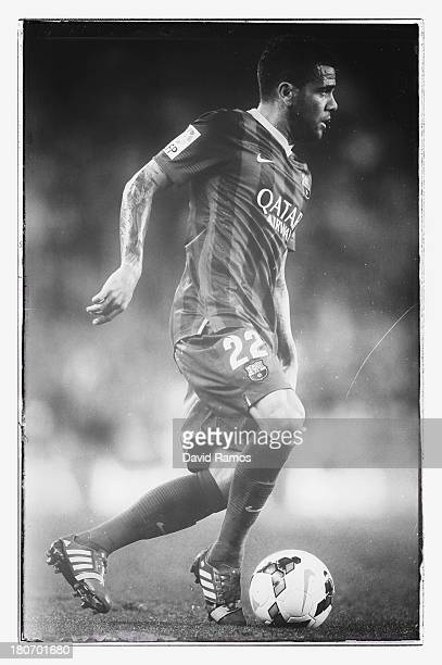 Dani Alves of FC Barcelona runs with the ball during the La Liga match between FC Barcelona and Sevilla FC at Camp Nou on September 14 2013 in...