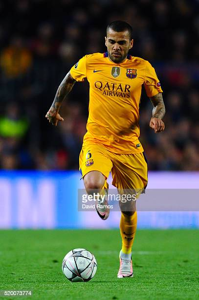 Dani Alves of FC Barcelona runs with the ball during the UEFA Champions League quarter final first leg match between FC Barcelona and Club Atletico...