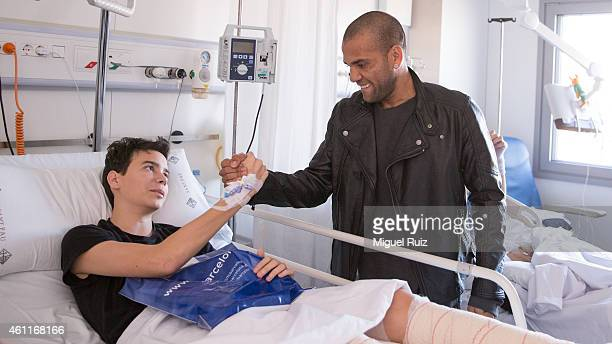 Dani Alves of FC Barcelona visits sick children as part of the 'A Dream for a Gift' Campaign on January 5 2015 in Barcelona Spain
