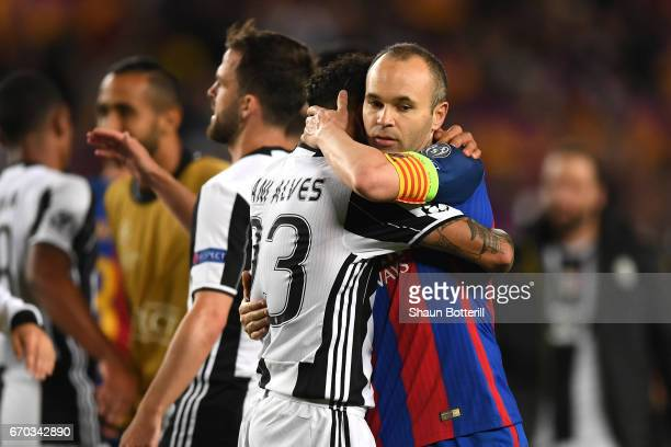 Dani Alves of Juventus and Andres Iniesta of Barcelona embrace after the UEFA Champions League Quarter Final second leg match between FC Barcelona...