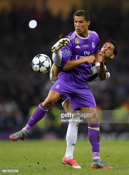 Dani Alves of Juventus and Cristiano Ronaldo of Real Madrid battle for possession during the UEFA Champions League Final between Juventus and Real...