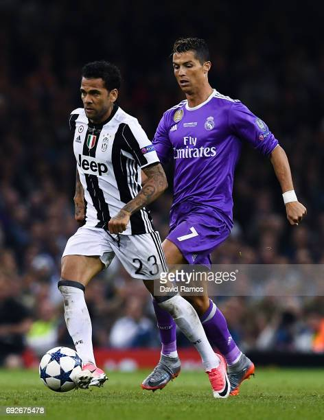 Dani Alves of Juventus and Cristiano Ronaldo of Real Madrid CF compete for the ball during the UEFA Champions League Final between Juventus and Real...